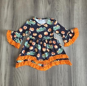 Trucks, pumpkins and lace dress